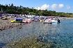 Rhodos Kiotari pláž slunce slunečníky moře vodní sporty Řecko