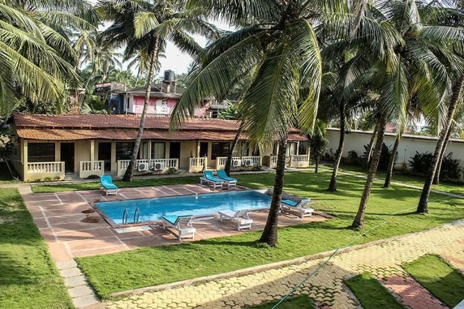Hotel Morjim Coco Palms Resort (fotografie 1)